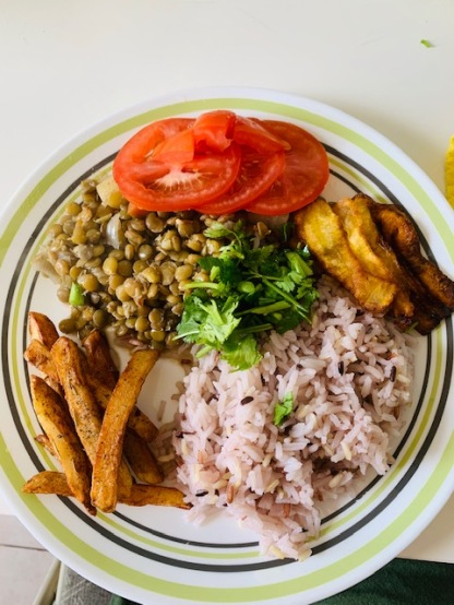 Lentils is a must at this house. Also some wild rice, veggies and plantains.
